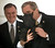 President Bush holds up his dog, Barney, and waves his paw to members of the media during his arrival at the South Lawn of the White House in this Wednesday, Feb. 27, 2002 file photo in Washington. In the back Gary Walters, chief usher at the White House. The chief usher of the Executive Mansion, Walters is retiring after more than 30 years _ and taking with him an intimate knowledge of everyday life at 1600 Pennsylvania Ave.