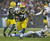 Green Bay Packers defensive end Mike Daniels (76) picks up a fumble by Detroit Lions quarterback Matthew Stafford and runs it back 43-yards for a touchdown during the first half of an NFL football game Sunday, Dec. 9, 2012, in Green Bay, Wis. (AP Photo/Jeffrey Phelps)