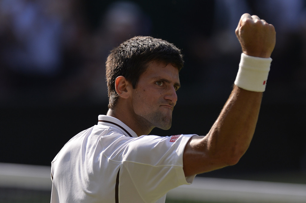 Description of . Serbia\'s Novak Djokovic celebrates beating Argentina\'s Juan Martin Del Potro during their men\'s singles semi-final match on day eleven of the 2013 Wimbledon Championships tennis tournament at the All England Club in Wimbledon, southwest London, on July 5, 2013. Djokovic won 7-5, 4-6, 7-6, 6-7, 6-3. ADRIAN DENNIS/AFP/Getty Images