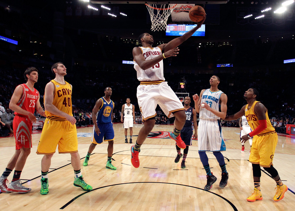 Description of . HOUSTON, TX - FEBRUARY 15:  Tristan Thompson #13 of the Cleveland Cavaliers and Team Chuck goes up for a shot in the BBVA Rising Stars Challenge 2013 part of the 2013 NBA All-Star Weekend at the Toyota Center on February 15, 2013 in Houston, Texas.  (Photo by Pool/Getty Images)