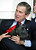 President Bush holds his dog Barney after it came into the room and frightened area children as Bush participated in the White House children's story hour, Tuesday, Dec. 17, 2002, in the Roosevelt Room of the White House in Washington. (AP Photo/Ron Edmonds)