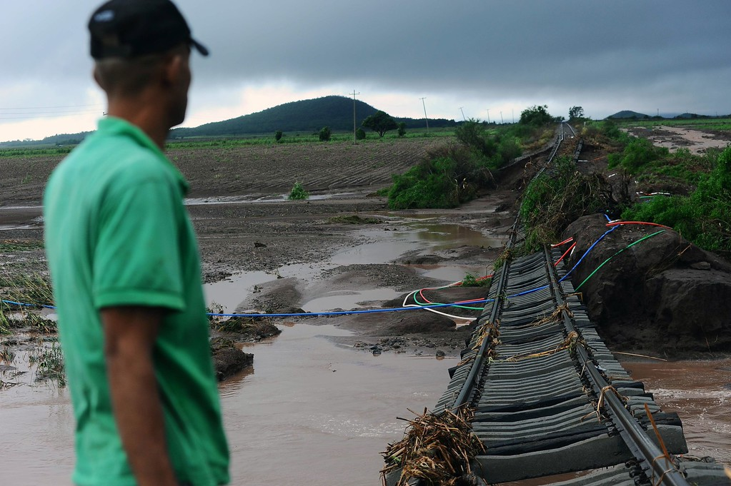Description of . Damage caused to the rail tracks in El Zapotillo by the overflowing of the neighboring river, in the state of Sinaloa, Mexico, on September 19, 2013. Deaths from floods and landslides battering Mexico neared 100 on Thursday as a fresh hurricane hit the northwest and rescuers faced a risky mission in a village buried in mud.  Fernando Brito/AFP/Getty Images