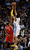 DENVER, CO. - JANUARY 30: Denver Nuggets shooting guard Andre Iguodala (9) takes a shot over Houston Rockets shooting guard James Harden (13)  during the third quarter January 30, 2013 at Pepsi Center. The Denver Nuggets take on the Houston Rockets in NBA action. (Photo By John Leyba/The Denver Post)