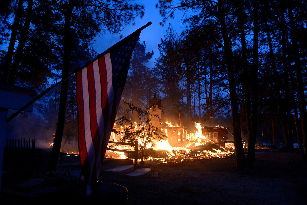 Description of . A house is fully engulfed with flames in the midst of the Black Forest Fire northeast of Colorado Springs on June 12, 2013.  .   Photo by Helen H. Richardson/The Denver Post)