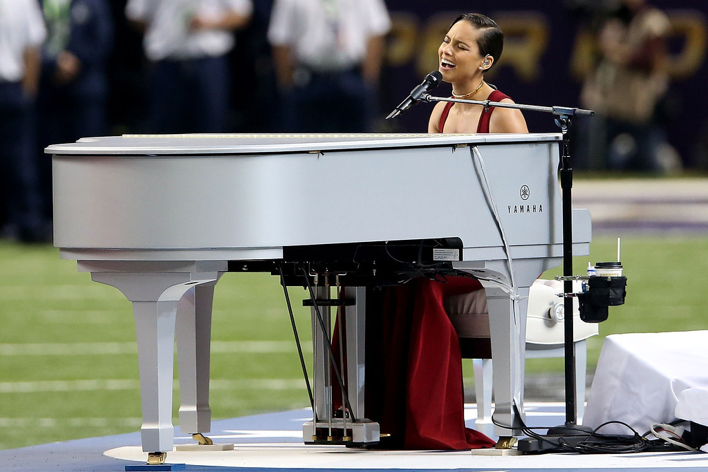 Description of . Alicia Keys performs the National Anthem during Super Bowl XLVII between the Baltimore Ravens and the San Francisco 49ers at the Mercedes-Benz Superdome on February 3, 2013 in New Orleans, Louisiana.  (Photo by Ronald Martinez/Getty Images)