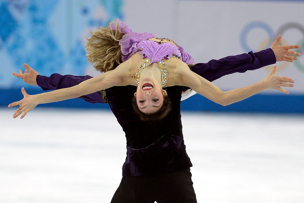 Description of . American gold medalists Charlie White and Meryl Davis perform during the figure skating ice dancing free dance medal round. Sochi 2014 Winter Olympics on Monday, February 17, 2014. (Photo by AAron Ontiveroz/The Denver Post)