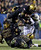Army's Anthony Stephens, top, is stopped by Navy's Keegan Wetzel, during the second half of an NCAA college football game Saturday, Dec. 8, 2012, in Philadelphia. Navy won 17-13. At bottom Ryan Powis (52) and Stephen Shumaker (70).  (AP Photo/Matt Rourke)