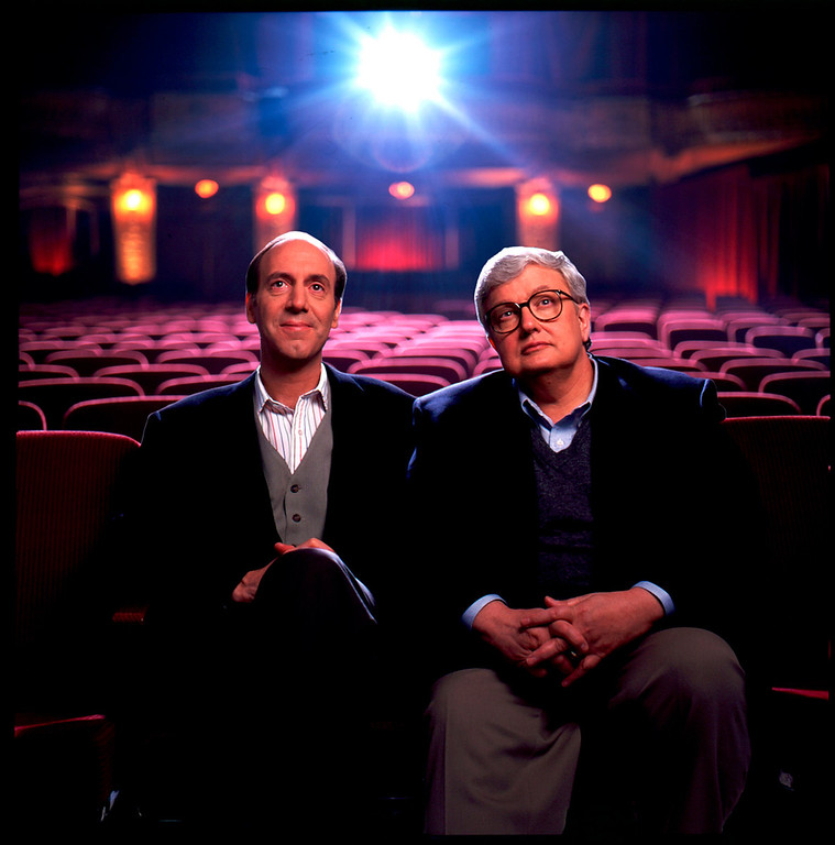 Description of . In this undated photo released by Disney-ABC Domestic Television, movie critics Roger Ebert, right, and Gene Siskel are shown. Starting Thursday, Aug. 2, 2007, a new web site touted as the largest collection of video-based movie reviews online will begin. The site will feature clips from the show that made the thumb famous and include 5,000 movie reviews, spanning more than 20 years of the show hosted by newspaper film critics Roger Ebert and the late Gene Siskel and columnist Richard Roeper. (AP Photo/Disney-ABC Domestic Television)