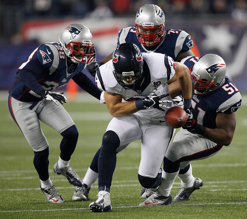Description of . Houston Texans tight end Owen Daniels loses the ball while being stopped by New England Patriots\' Steve Gregory, Brandon Deaderick and Jerod Mayo during the second half of an AFC divisional playoff NFL football game in Foxborough, Mass., Sunday, Jan. 13, 2013. The play had been stopped before Daniels dropped the ball. (AP Photo/Stephan Savoia)