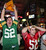 Greenbay Packers fan Casey Lansdon, left, and San Francisco 49ers fan Ryan Dunn react to a Packers touchdown as they watch a broadcast of an NFC divisional playoff NFL football game on Saturday, Jan. 12, 2013, at The Graduate in Chico, Calif.  (AP Photo/The Chico Enterprise-Record, Jason Halley)