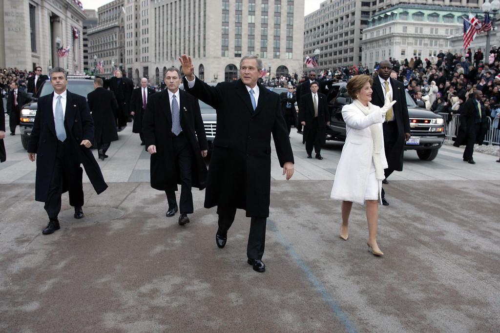 Description of . President Bush and first lady Laura Bush walk during the inauguration parade in front of the White House. Thursday, Jan. 20, 2005, in Washington. (AP Photo/Doug Mills/Pool)