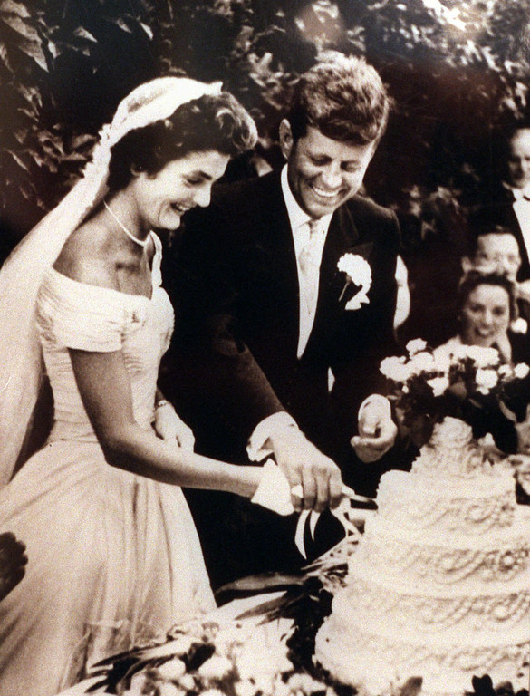 Description of . The newlywed Kennedys cut the cake at their wedding Sept. 12, 1953. Cecil Yates, Associated Press file