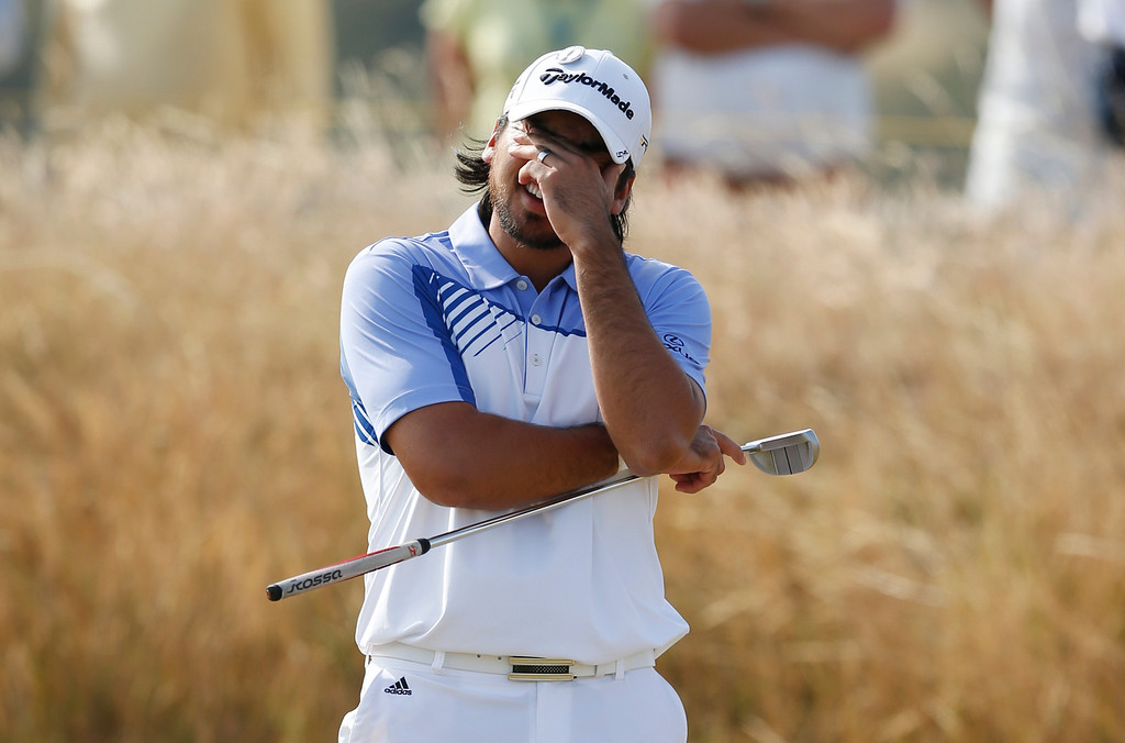 Description of . Jason Day of Australia reacts on the 17th green during the third round of the British Open Golf Championship at Muirfield, Scotland, Saturday July 20, 2013. (AP Photo/Matt Dunham)
