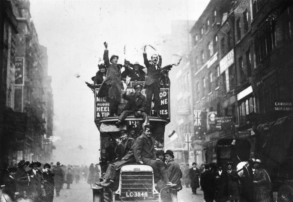 Description of . 11th November 1918:  Crowds celebrating the signing of the Armistice at the end of World War I.  (Photo by Topical Press Agency/Getty Images)