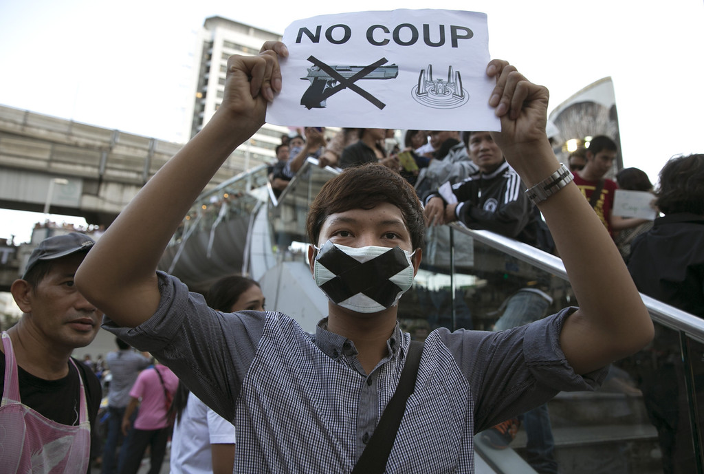 Description of . A Thai protester shows his disapproval with the military during an anti-coup protest despite the martial law May 23, 2014 in Bangkok, Thailand.  (Photo by Paula Bronstein/Getty Images)