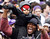 Fans of Super Bowl XLVII champion Baltimore Ravens celebrate their victory before a stadium rally in Baltimore February 5, 2013. The Ravens defeated the San Francisco 49ers to win the NFL championship.     REUTERS/Gary Cameron