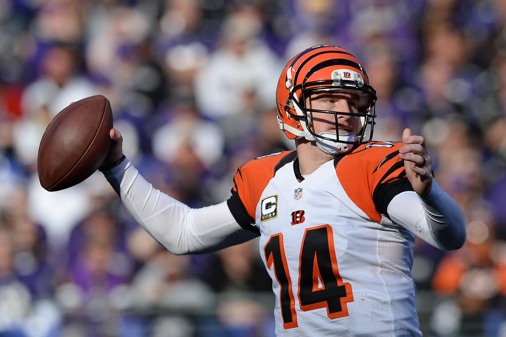 Description of . Quarterback Andy Dalton #14 of the Cincinnati Bengals looks to pass against the Baltimore Ravens in the second quarter at M&T Bank Stadium on November 10, 2013 in Baltimore, Maryland. (Photo by Patrick Smith/Getty Images)