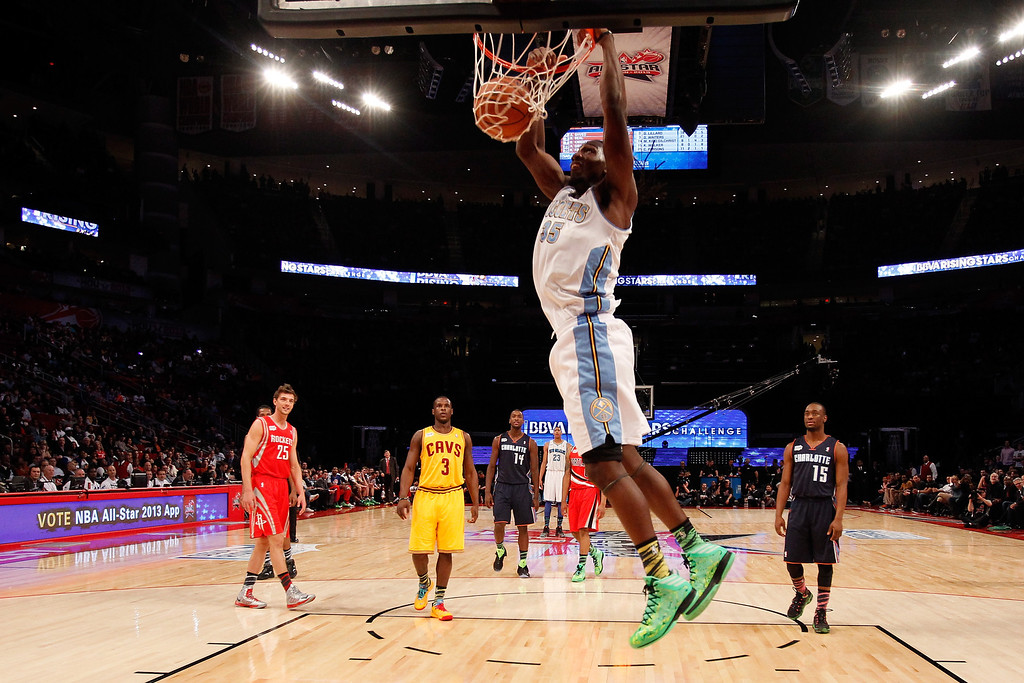 Description of . HOUSTON, TX - FEBRUARY 15:  Kenneth Faried #35 of the Denver Nuggets and Team Chuck dunks the ball in the second half in the BBVA Rising Stars Challenge 2013 part of the 2013 NBA All-Star Weekend at the Toyota Center on February 15, 2013 in Houston, Texas.   (Photo by Lucy Nicholson/Pool/Getty Images)