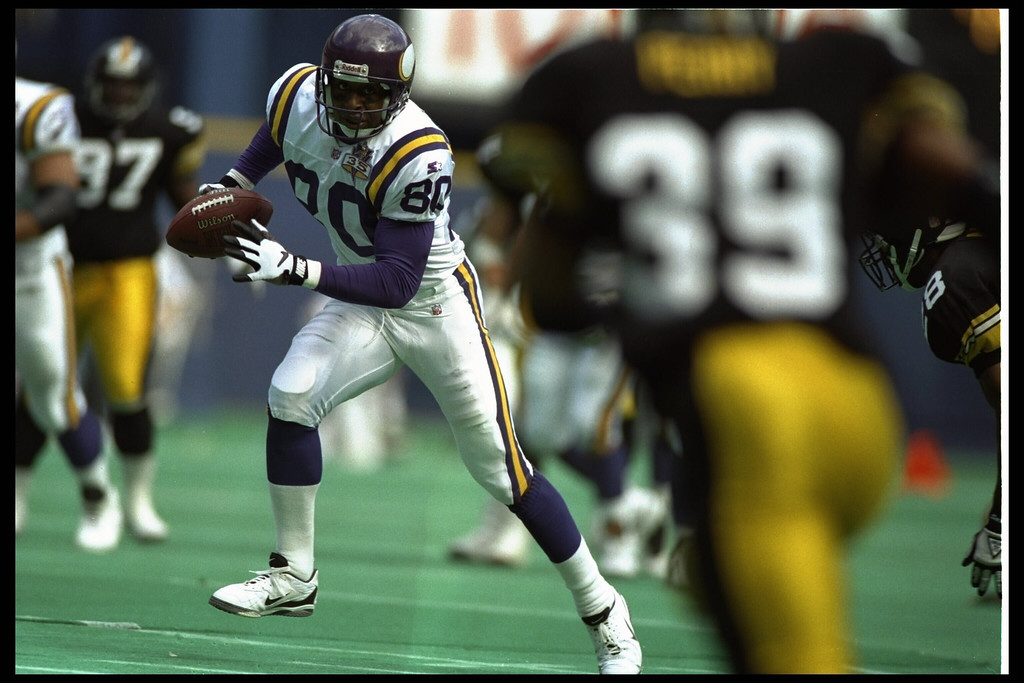 Description of . 24 SEP 1995:  MINNESOTA WIDE RECEIVER CRIS CARTER #80 RUNS DOWN FIELD AFTER A CATCH DURING THE VIKINGS 44-24 VICTORY OVER THE PITTSBURGH STEELERS AT THREE RIVERS STADIUM IN PITTSBURGH, PENNSYLVANIA.  (Photo by Doug Pensinger/Getty Images)