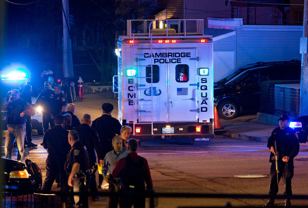 Description of . A bomb squad truck arrives at an incident Friday, April 19, 2013, in Watertown, Mass. in which shots were reported to have been fired. (AP Photo/Craig Ruttle)