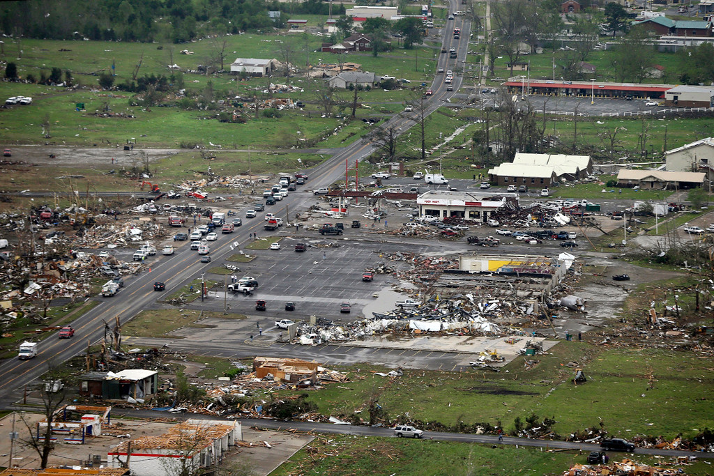 Description of . In this aerial photo, destroyed businesses along U.S. Highway 64 sit among rubble in Vilonia, Ark., Monday, April 28, 2014. A tornado struck the town late Sunday. Vilonia was hit hard Sunday for the second time in three years. Four people were killed in a 2011 storm. (AP Photo/Danny Johnston)