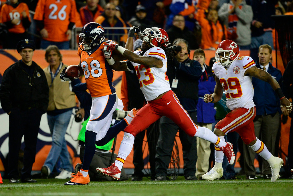 Description of . Denver Broncos wide receiver Demaryius Thomas (88) tries to push off Kansas City Chiefs free safety Kendrick Lewis (23) in the second quarter. The Denver Broncos take on the Kansas City Chiefs at Sports Authority Field at Mile High in Denver on November 17, 2013. (Photo by AAron Ontiveroz/The Denver Post)