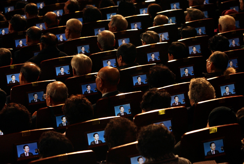 . In this March 1, 2012 file photo, small screens show South Korean President Lee Myung-bak as participants listen to his speech during the 93th anniversary ceremony of Independence Movement Day, a public holiday to remember activists who fought for Korean independence against Japanese colonization, in Seoul, South Korea. (AP Photo/Ahn Young-joon, File)
