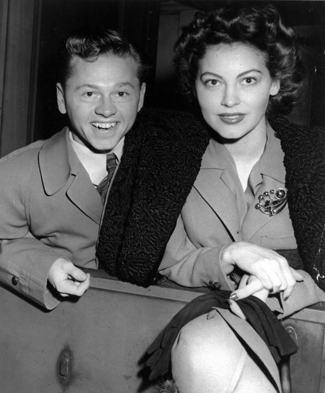 Description of . Mickey Rooney and wife, Ava Gardner, arrive in New York in January 1942, en route to Boston where Rooney is to appear at a Red Cross benefit.  (AP Photo/File)