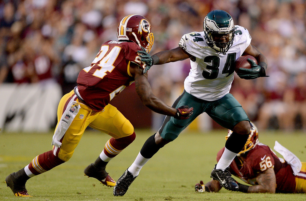 Description of . Running back Bryce Brown #34 of the Philadelphia Eagles runs the ball in the first half against strong safety Bacarri Rambo #24 of the Washington Redskins at FedExField on September 9, 2013 in Landover, Maryland.  (Photo by Patrick Smith/Getty Images)