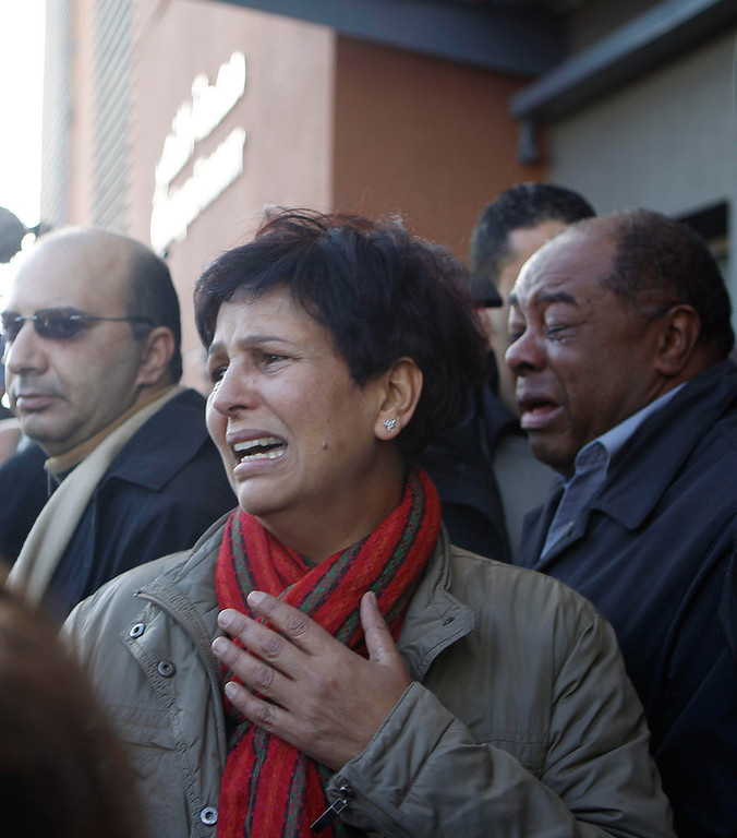 Description of . A woman mourns for assassinated prominent Tunisian opposition politician Shokri Belaid in Tunis, February 6, 2013. A prominent Tunisian opposition politician was shot dead outside his home on Wednesday, in a killing the prime minister condemned as a political assassination and a strike against the