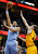 Denver Nuggets' JaVale McGee shoots over Cleveland Cavaliers' Tyler Zeller during the third quarter of an NBA basketball game Saturday, Feb. 9, 2013, in Cleveland. The Nuggets won 111-103. (AP Photo/Mark Duncan)