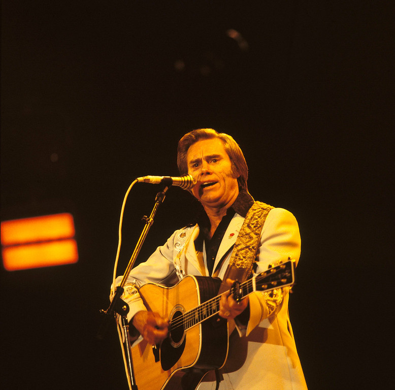 . On April 26, 2013 Country Music Hall of Fame singer and George Jones died aged 81 in Saratoga, Texas, United States. George Jones performs on stage at the Country Music Festival held at Wembley Arena, London in April 1981. (Photo by David Redfern/Redferns)