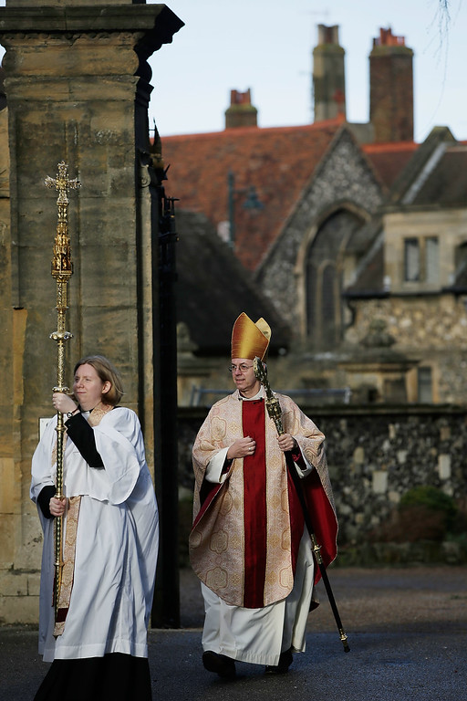 Description of . CANTERBURY, ENGLAND - DECEMBER 25:  The Archbishop of Canterbury Justin Welby arrives for Christmas Day Mass at Cantebury Cathedral on December 25, 2013 in Canterbury, England. Today marks the Archbishop's first Christmas since being enthroned in the position.  (Photo by Matthew Lloyd/Getty Images)