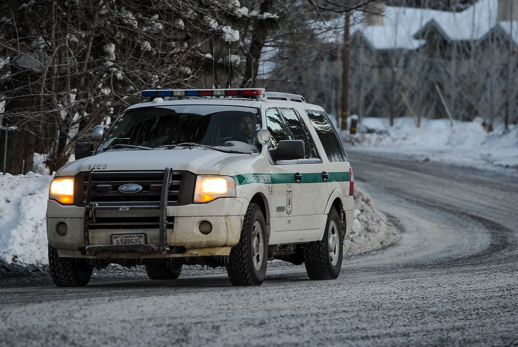 . A patrol vehicle returns to the command post near Bear Mountain Resort at the start of day four in the search for fugitive ex-cop Christopher Dorner in Big Bear on Sunday, Feb. 10, 2013. (Rachel Luna / Staff Photographer)