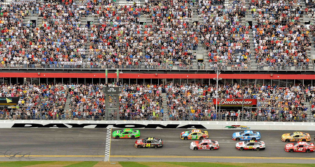 Description of . NASCAR driver Danica Patrick (10) leads the field on the first lap during the NASCAR Sprint Cup Series Daytona 500 race at the Daytona International Speedway in Daytona Beach, Florida February 24, 2013. REUTERS/Brian Blanco