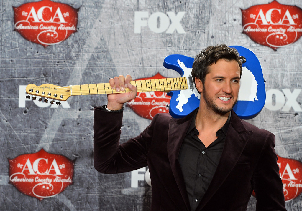 Description of . LAS VEGAS, NV - DECEMBER 10:  Singer Luke Bryan poses in the press room after winning multiple awards during the 2012 American Country Awards at the Mandalay Bay Events Center on December 10, 2012 in Las Vegas, Nevada.  (Photo by Frazer Harrison/Getty Images)