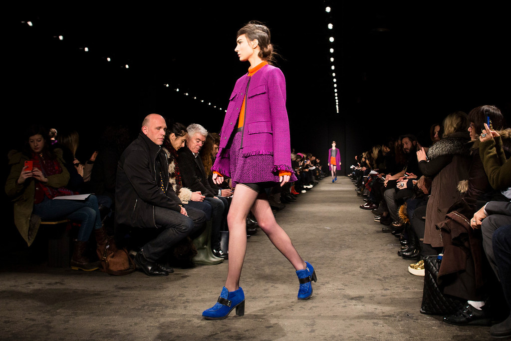 Description of . A model walks the runway at the presentation of the Rag & Bone Fall 2013 fashion collection during Fashion Week, Friday, Feb. 8, 2013, in New York. (AP Photo/John Minchillo)