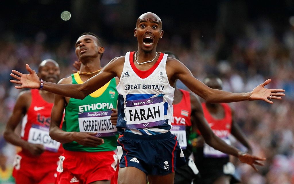 Description of . Britain's Mo Farah reacts as he wins the men's 5000m final at the London 2012 Olympic Games at the Olympic Stadium August 11, 2012.  REUTERS/Lucy Nicholson