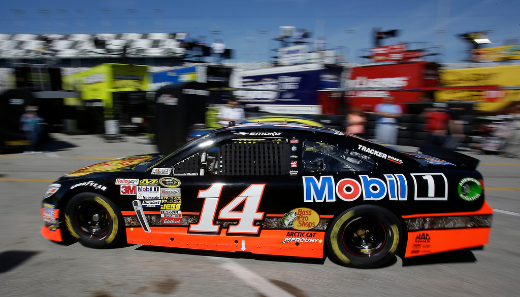. Tony Stewart drives out on the track during practice for the NASCAR Daytona 500 Sprint Cup Series auto race at Daytona International Speedway, Wednesday, Feb. 20, 2013, in Daytona Beach, Fla. (AP Photo/John Raoux)
