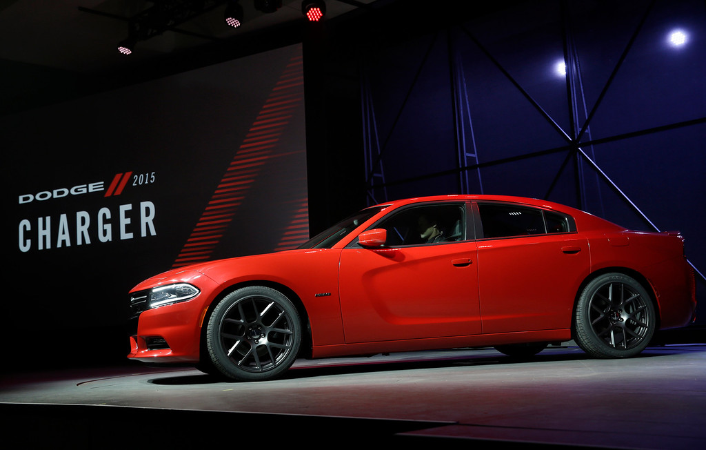 Description of . The 2015 Dodge Charger is introduced at the New York International Auto Show in New York, Thursday, April 17, 2014.  (AP Photo/Seth Wenig)