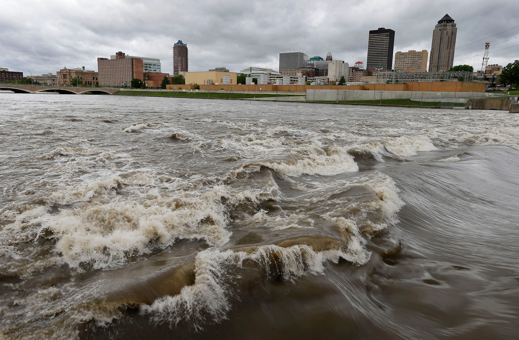 Description of . n this May 30, 2013, file photo, water splashes over the Center Street Dam in the swollen Des Moines River in downtown Des Moines, Iowa.  (AP Photo/Charlie Neibergall, File)
