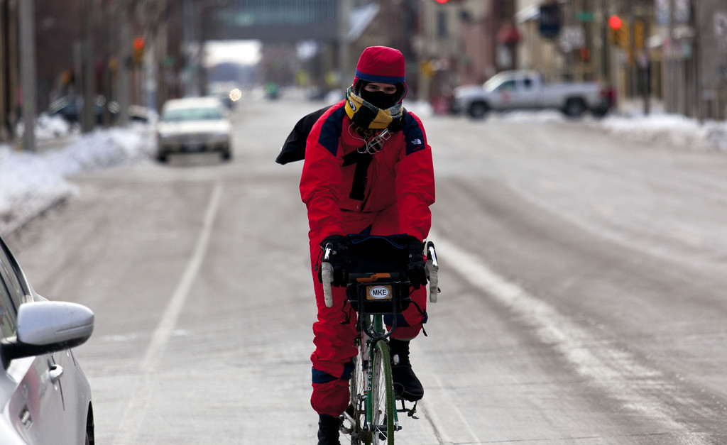 Description of . A cyclist braves the cold as temperatures remain in the negative digits on January 7, 2014 in Milwaukee, Wisconsin. A 'polar vortex' of frigid air centered on the North Pole dropped temperatures to the negative double digits at its worst. (Photo by Darren Hauck/Getty Images)