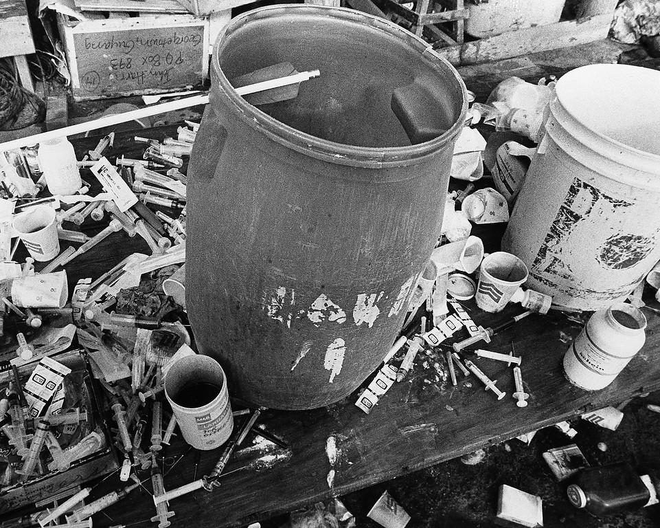 Description of . Syringes surround one of the vats used to mix the drink used in a mass suicide for more than 900 people at the religious cult town of Jonestown, Guyana on Nov. 26, 1978. Leader Jim Jones lead the group claiming they would be transported to another planet where they would live in peace in a new eden avoiding the nuclear fire that would engulf the earth. (AP Photo/Val Mazzenga)