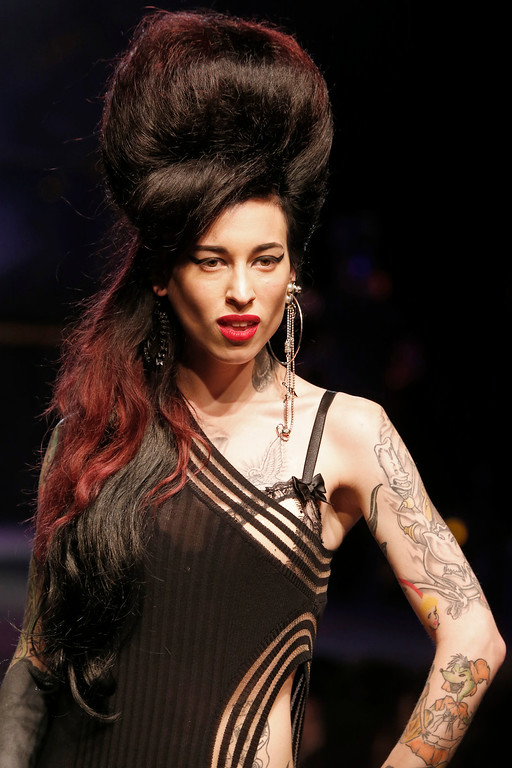 Description of . A model presents a creation as part of Jean-Paul Gaultier's ready-to-wear Spring/Summer 2014 fashion collection, presented Saturday, Sept. 28, 2013 in Paris. (AP Photo/Jacques Brinon)