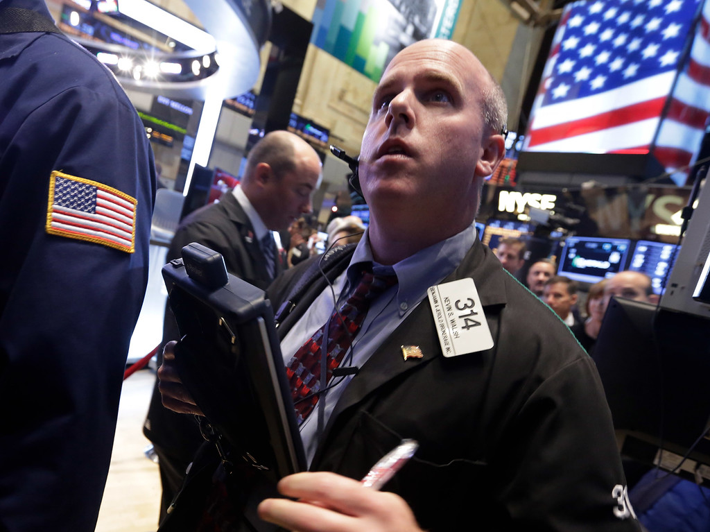 Description of . Trader Kevin Walsh works on the floor of the New York Stock Exchange Wednesday, Oct. 2, 2013. The stock market is opening lower as the U.S. government shutdown enters a second day with little hope for a resolution in sight. (AP Photo/Richard Drew)