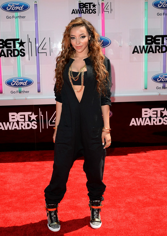 Description of . Singer Tinashe attends the BET AWARDS '14 at Nokia Theatre L.A. LIVE on June 29, 2014 in Los Angeles, California.  (Photo by Earl Gibson III/Getty Images for BET)