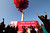 Activists release balloons during an event to support