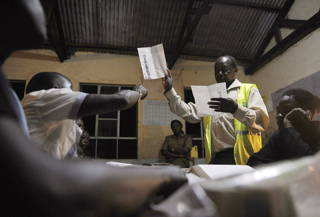 Description of . Poll officials count ballots at a polling centre following Kenya's national elections on March 4, 2013 in the country's western province in Kakamega. Long lines of Kenyans queued from way before dawn to vote today in the first election since the violence-wracked polls five years ago, with a deadly police ambush hours before polling started marring the key ballot. The tense elections are seen as a crucial test for Kenya, with leaders vowing to avoid a repeat of the bloody 2007-8 post-poll violence in which over 1,100 people were killed and observers repeatedly warning of the risk of renewed conflict.       TONY KARUMBA/AFP/Getty Images