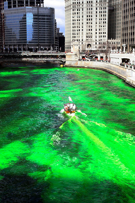 Description of . Workers mix an orange powder to dye the Chicago River green before the start of St. Patricks Day Parade March 17, 2007 in in Chicago, Illinois.The river is dyed with a orange food coloring that is safe for the environment. (Photo by Tasos Katopodis/Getty Images)