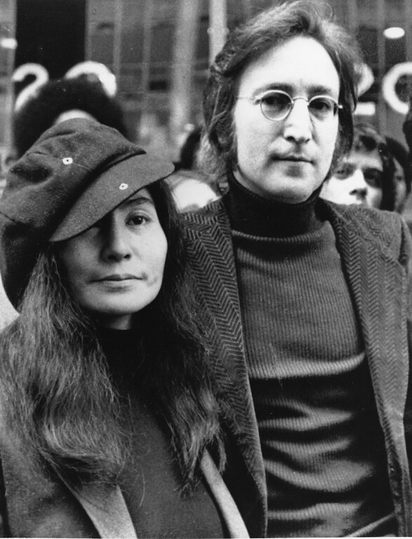 Description of . In this file photo dated April 18, 1972, John Lennon, right, and Yoko Ono, left, are seen outside the U.S. Immigration offices in New York City, USA. Vatican media praised the Beatles' musical legacy on Saturday, Nov. 22, 2008. John Lennon's boast that the British band was more popular than Jesus outraged many when he made it in 1966, Vatican newspaper L'Osservatore Romano noted, but that the remark can be written off now as the bragging of a young man wrestling with unexpected success. (AP Photo, File)